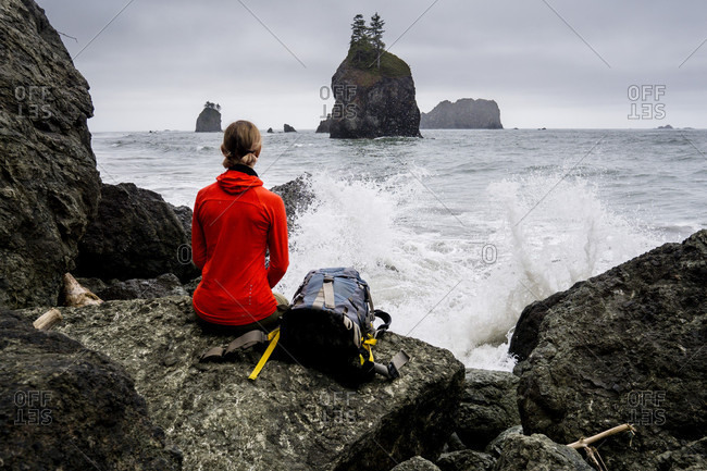 A Woman Looking At The Waves On The Coast Of Olympic National Park
