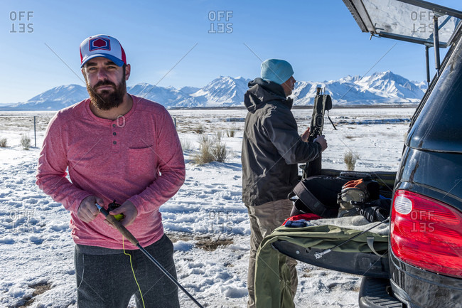 Two Men Preparing For Fly Fishing In Upper Owens River, Usa