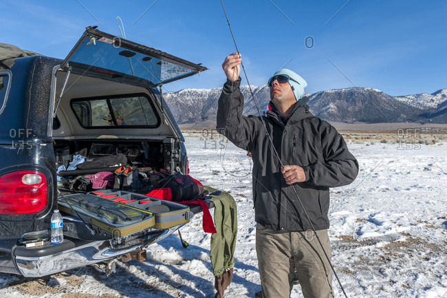 Fisherman Rigging A Fly Rod On The Upper Owens River