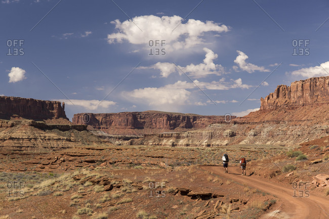 Long Exposure Of People Hiking In Canyonlands National Park