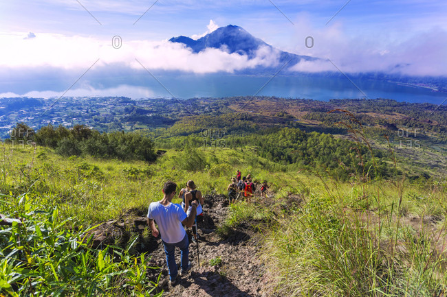 Group Of Hikers Hiking On The Caldera Of Volcano Of Batur