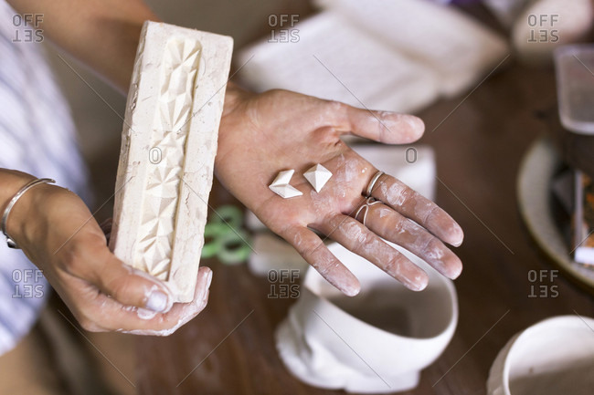 Woman Hand Holding Clay Brick In Ceramic Workshop