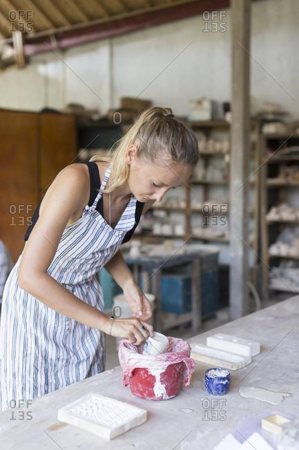 Ubud, Bali - June 4, 2016: Young Woman Working In Ceramic Workshop