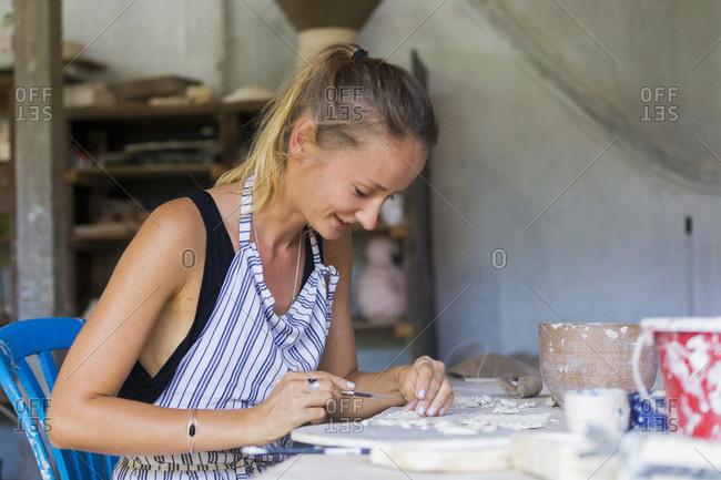 Ubud, Bali - June 4, 2016: Artistic Woman Working On Mold In Ceramic Workshop