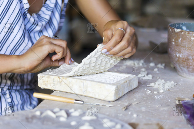 Woman Hand Using Brush On Piece Of Mold