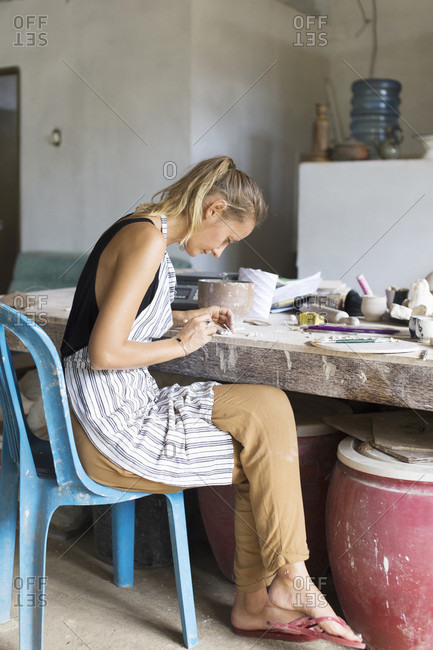 Ubud, Bali - June 4, 2016: Artistic Woman Using Brush On Mold In Ceramic Workshop