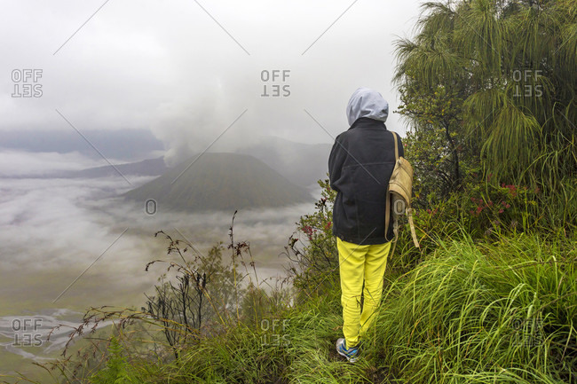 Female Hiker Standing On Mountain In East Java, Indonesia