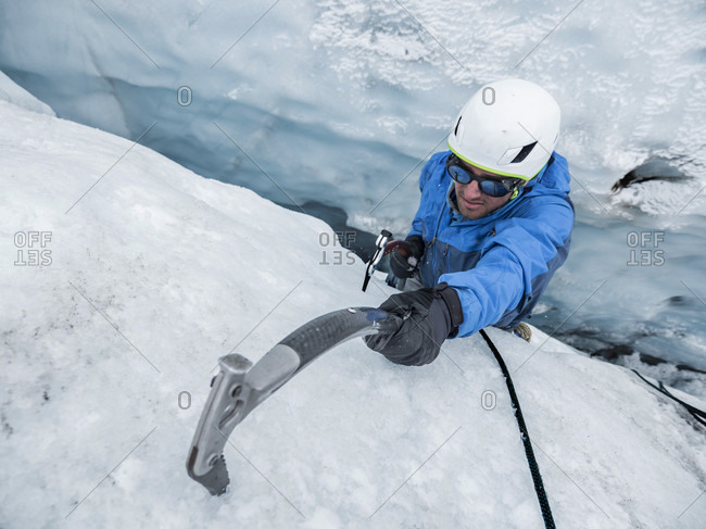 A Man Ice Climbing In A Crevasse On The Coleman Glacier On Mount Baker