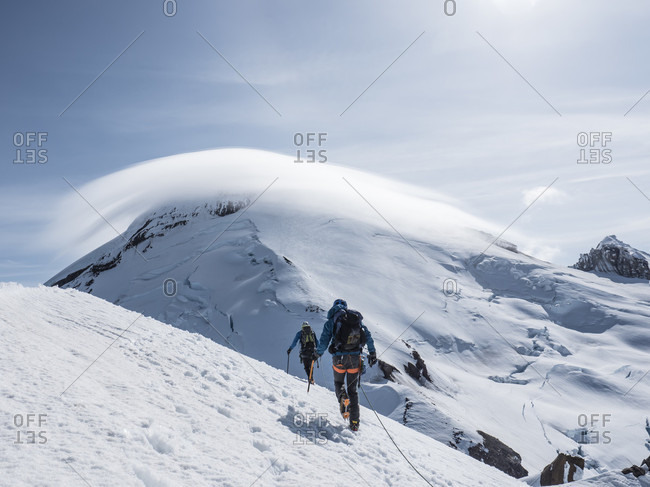 Two Climbers Hiking From Summit Of Colfax Peak