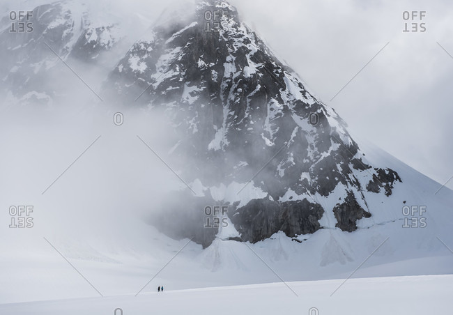 Two Climbers Below Mount Barril In Denali National Park