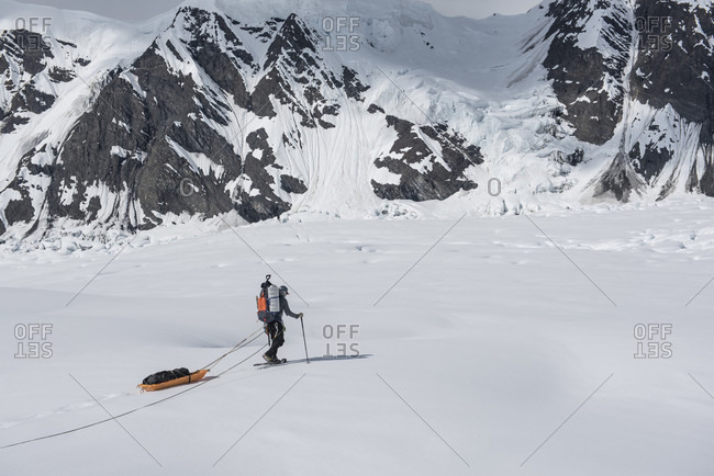 Person Dragging A Sled Across The Ruth Glacier In Denali National Park