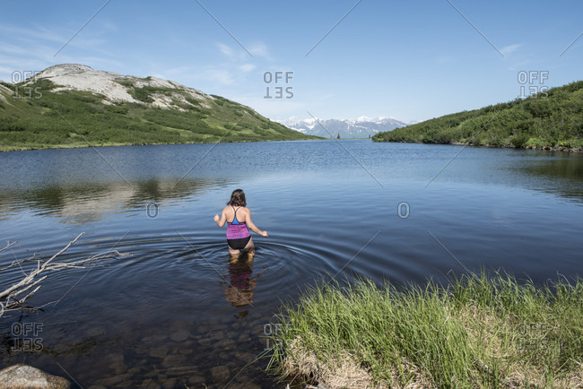 A Woman In Alpine Lake On The Ermine Hill Hike In Denali State Park