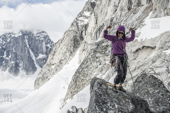 Happy Woman Flexing Her Muscles While Rock Climbing In Little Switzerland