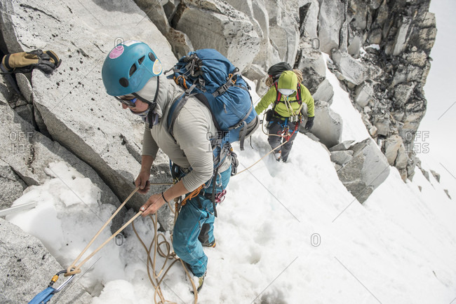 A Woman Belays Her Climbing Partner Above The Pika Glacier In Denali National Park