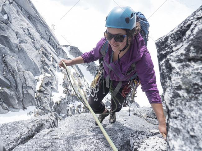 A Woman Climbing Middle Troll In Little Switzerland In Denali National Park
