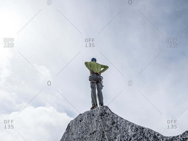 Man Standing On Top Of Middle Troll In Little Switzerland