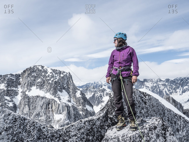 Woman Standing On Top Of Middle Troll In Little Switzerland, Alaska, Usa