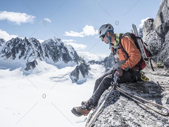 A Man Preparing For Rappelling In Denali National Park, Alaska, Usa