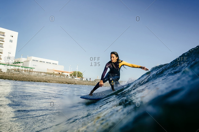 Surfer Girl Rides Her Longboard During Sunset