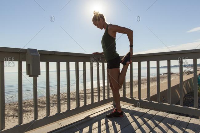Woman Doing Exercise Standing Near Beach