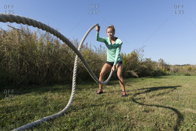 Woman With Ropes Working Out On Grass