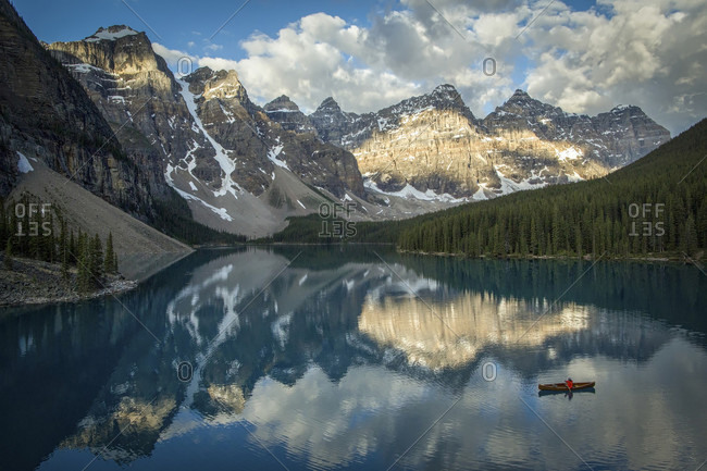 Long Exposure Of Person Canoeing In Moraine Lake