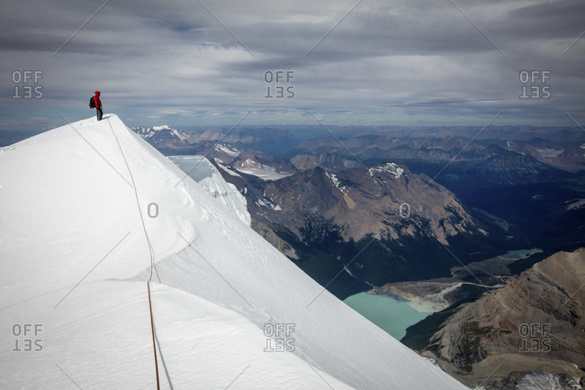 Person Climbing Mount Robson In British Columbia, Canada