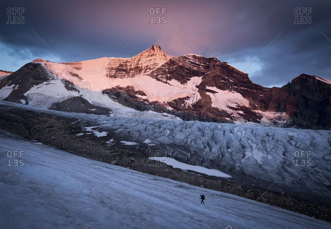 Long Exposure Of Person Climbing Mount Robson