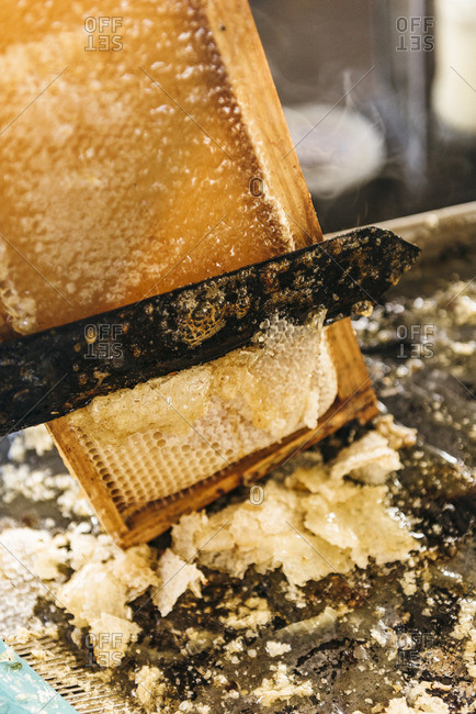Heated knife slides through honeycomb in the harvesting process