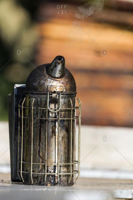 Close-up of a beekeeper's smoker