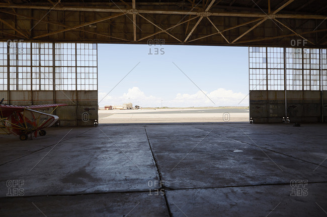 Ultra light aircraft and view out hanger door