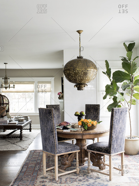 April 24, 2015: Dining area with high back chairs