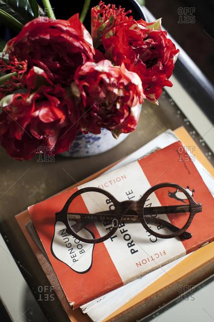 April 24, 2015: Round frame glasses on books