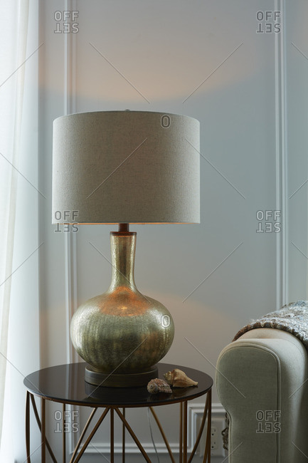 A lamp on a side table