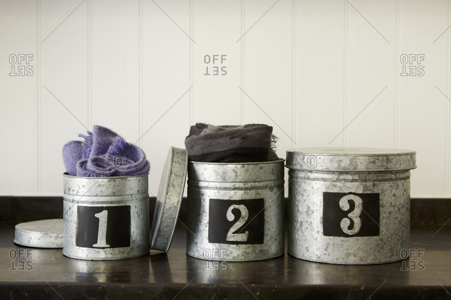 Metal canisters storing clothes