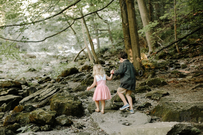 Kids holding hands in a forest