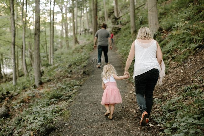 Family on a forest trail
