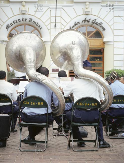 8/28/07: Two tuba players from The Banda de Musica De Los Bomberos de Republica Dominicana practice in Colon Park, Santo Domingo, Dominican Republic