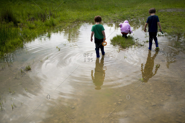 Kids playing in a wet field
