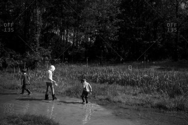 Kids exploring a wet field