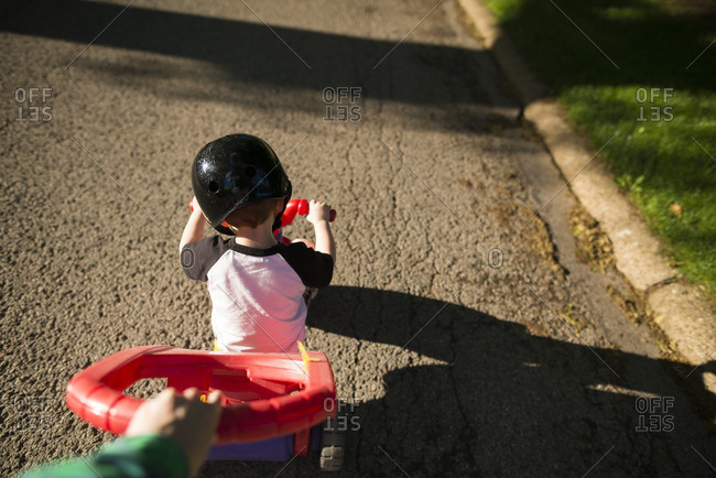 Boy being pushed in buggy