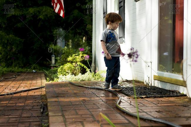 Boy at front door in summer