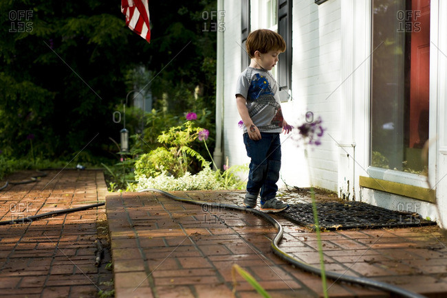 Boy at front door in summer