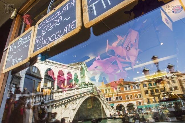 Bridge reflected in cafe window, Venice