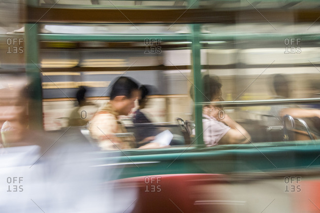 Travelers on a tram, Hong Kong