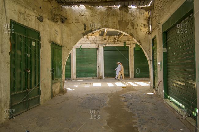 Libya, Tripoli - September 21, 2007: Men in closed market area, Tripoli
