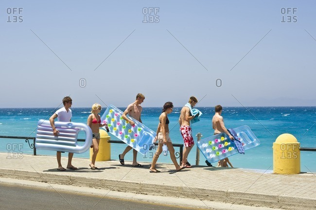Greece, Dodecanese - June 21, 2008: Young people going to the beach