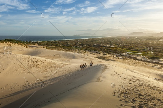 Brazil, Santa Catarina - December 11, 2012: Sand surfers in rural Brazil