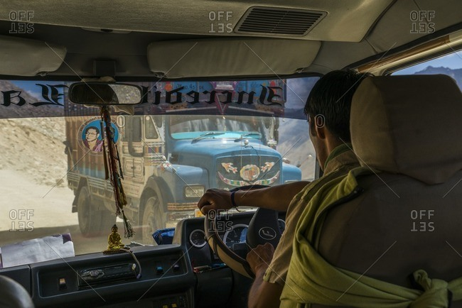 India, Ladakh - August 13, 2014: Man driving on mountain pass, India