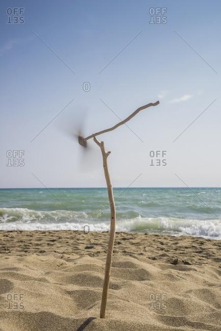 Pinwheel on sticks on a beach